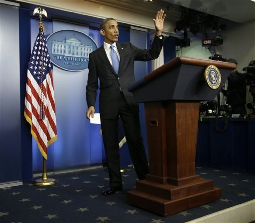 President Barack Obama waves as he walks away from the podium after a new conference in the Brady Press Briefing Room of the White House in Washington, Tuesday, April 30, 2013. The president strongly suggested Tuesday he'd consider military action against Syria if it can be confirmed that President