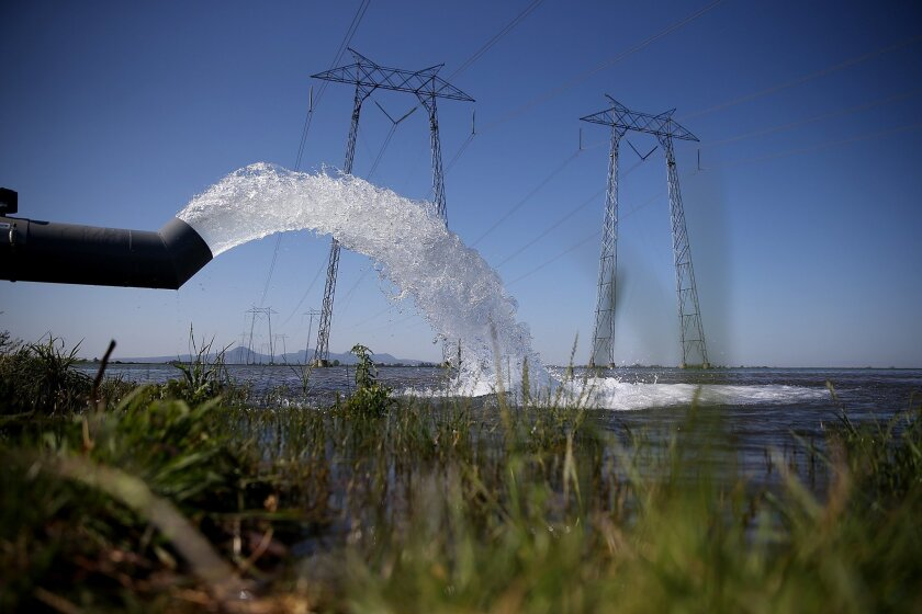 Water is pumped into a field that will be planted with rice on May 8 in Biggs, Calif. As California enters its fourth year of severe drought, a lack of water has rice farmers cutting back on their annual plantings.