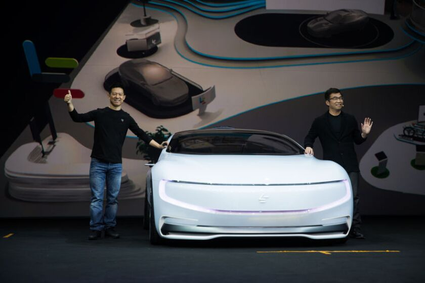 LeEco Chief Executive Jia Yueting and co-founder Ding Lei with the LeSEE, the company's first mainstream model car, in Beijing.