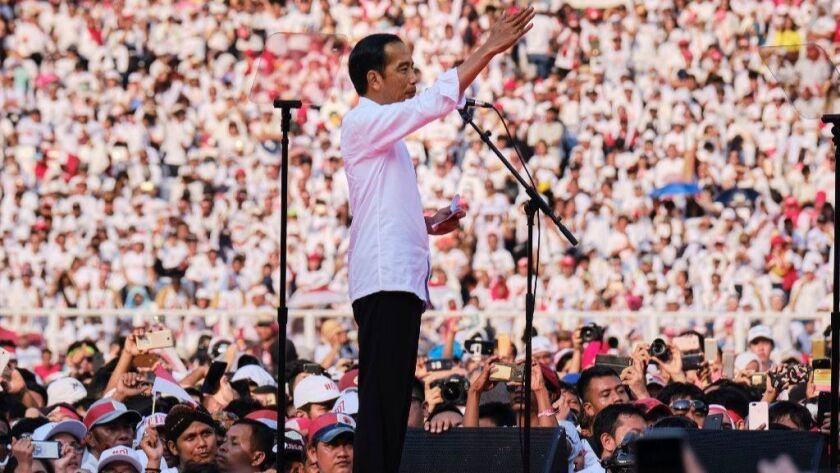 Indonesian President Joko Widodo addresses supporters at a rally at Jakarta's main stadium on April 13, 2019.