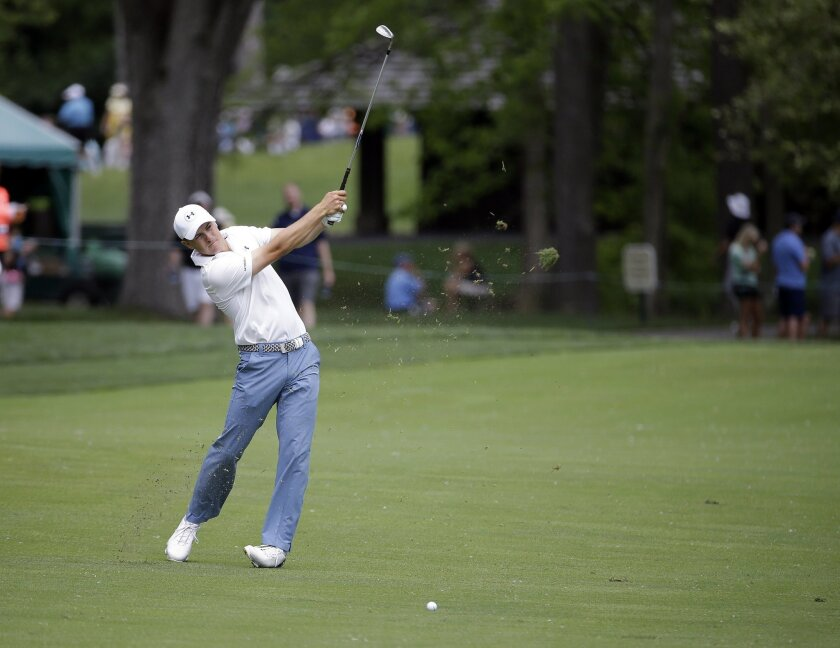 Jordan Spieth hits on the third hole during the third round of the Memorial golf tournament, Saturday, June 4, 2016, in Dublin, Ohio. (AP Photo/Darron Cummings)