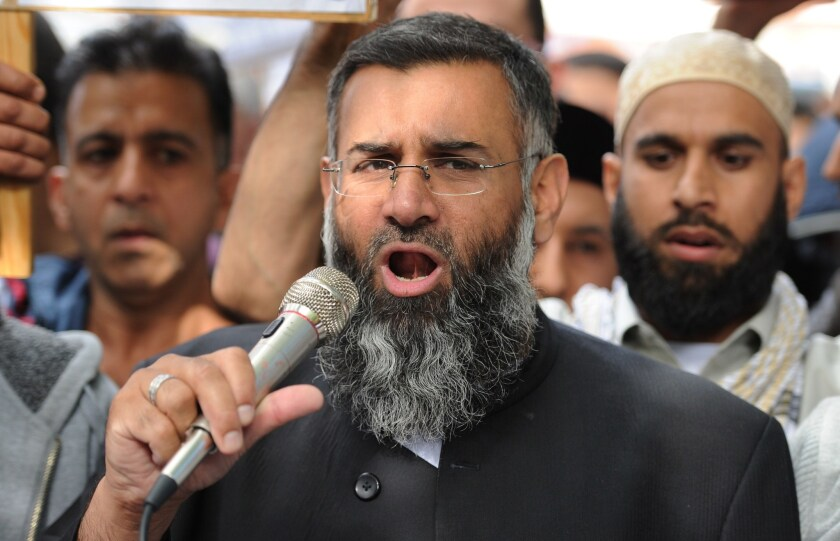 Islamist preacher Anjem Choudary speaks in 2012 to a group of demonstrators in London protesting against a film they considered insulting to Islam.