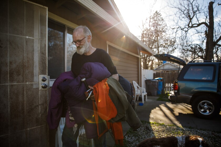David McGlamery returns to his Oroville home with his belongings after the evacuation order was lifted. The family had to retreat to Chico, where they initially stayed at a Walmart parking lot with other evacuees.