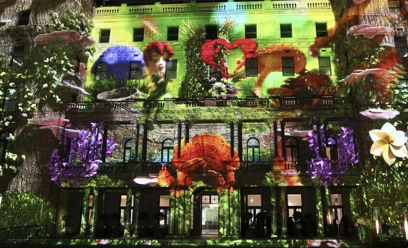 "Customs House is lit up with a light display called ""Sydney's Hidden Stories"" during a media preview of Vivid Sydney Light Walk at Circular Quay in Sydney, Australia, Thursday,  May 26, 2016. Vivid Sydney is an annual outdoor lighting festival of light installations, projections and interactive dis"
