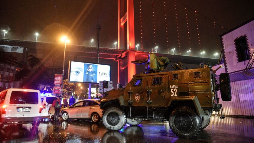 A police vehicle blocks the road leading to the scene of an attack in Istanbul, Turkey, last month.