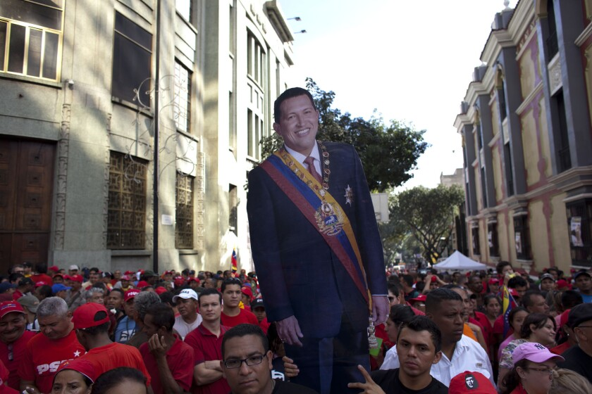 Supporters carry a life-size image of Venezuelan President Hugo Chavez during a symbolic inauguration ceremony Thursday in Caracas for the ailing leader. Chavez hasn't been seen or heard from in the month since he underwent cancer surgery in Cuba.