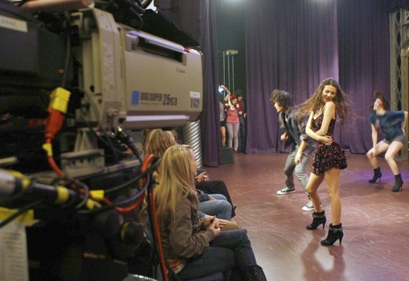 """Actress Victoria Justice(2nd from right) and the cast in the taping of a high school performance scene for the show """"Victorious"""" at Nickelodeon's studio in Hollywood."""