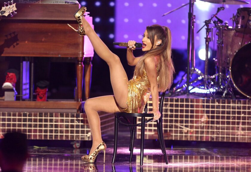 Ariana Grande, shown on stage at the American Music Awards in Los Angeles, is nominated for five Grammy Awards this year.