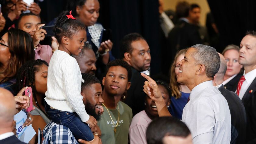 President Obama greets supporters at a rally in Fayetteville, N.C., on Friday for Hillary Clinton.