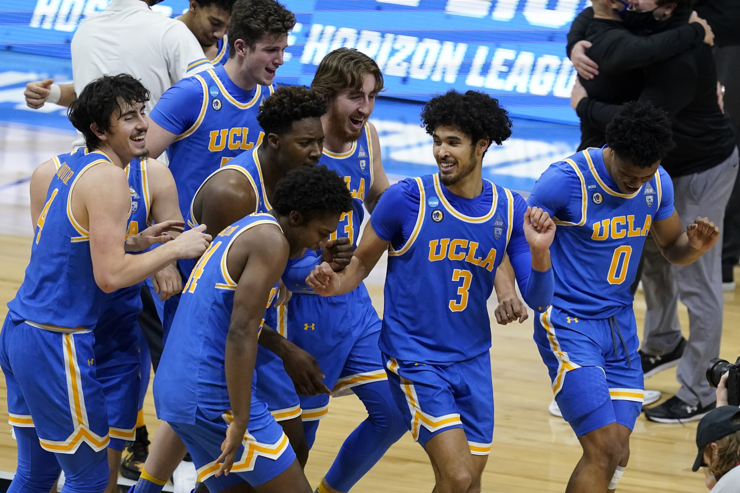 UCLA players celebrate after an Elite Eight game against Michigan in the NCAA men's college basketball tournament.