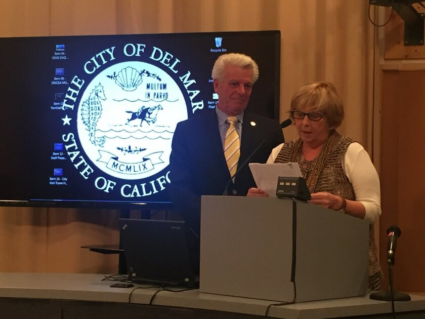 New Mayor Sherryl Parks reads a proclamation in honor of outgoing Mayor Al Corti's service.