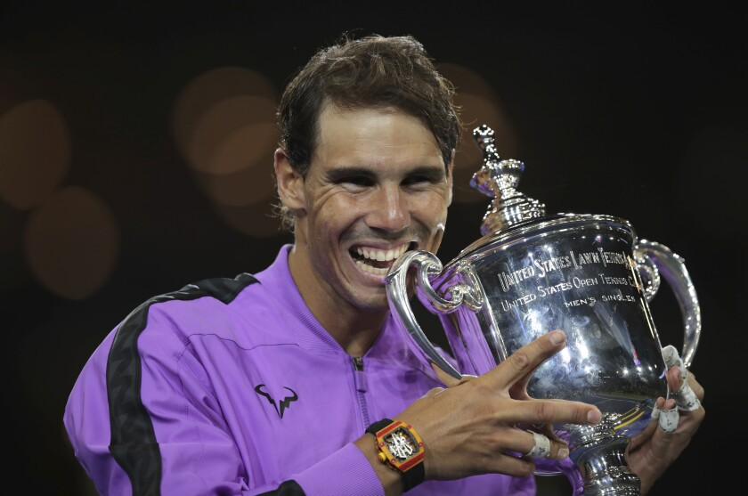 Rafael Nadal poses with the championship trophy after defeating Daniil Medvedev to win the men's singles title at the U.S. Open on Sunday.
