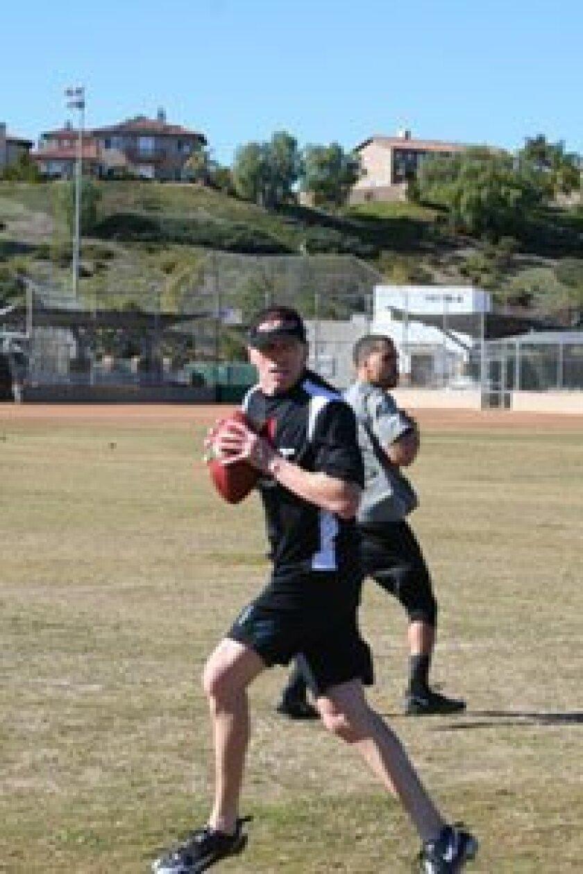 Jeff Garcia works with former SDSU quarterback Ryan Katz at a Velocity Sports/TEST West NFL Combine prep camp. Photos/Karen Billing