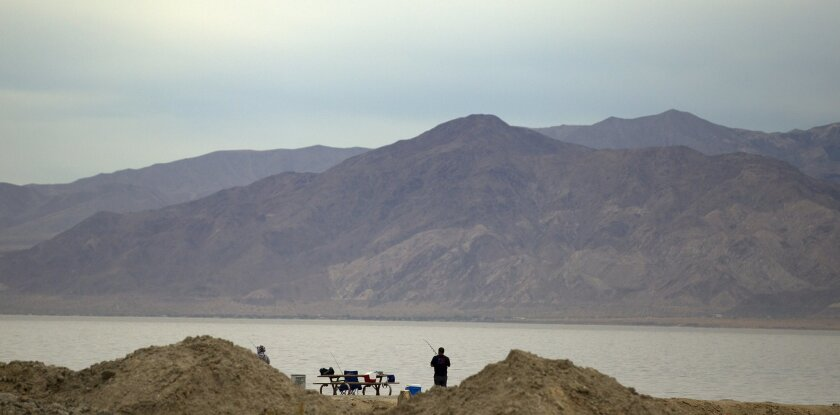 Fishermen fish at the Salton Sea State Recreation Area.