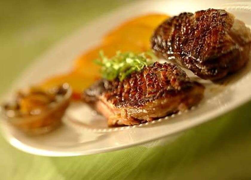 MADE FOR THE GRILL: A quick marinade and an eight-minute sizzle, and you have a spectacular summer meal. Grilled duck breasts with savory ginger-peach chutney are a sophisticated alternative to the usual barbecued steak and ribs of the season.