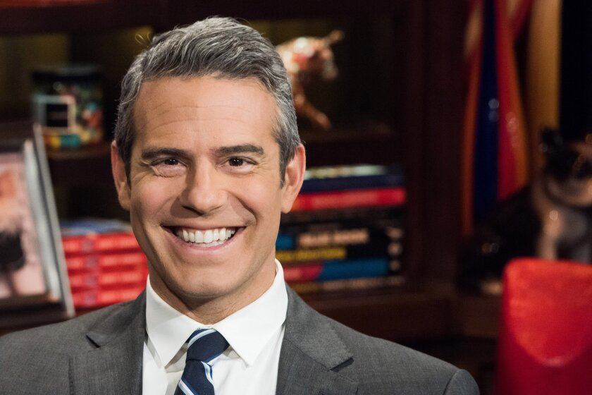 """In this Nov. 5, 2014 photo, host Andy Cohen poses for a portrait on the set of his show, """"Watch What Happens Live,""""  in New York. Cohen has published a second book, """"The Andy Cohen Diaries: A Deep Look at a Shallow Year."""" (AP Photo/Charles Sykes)"""