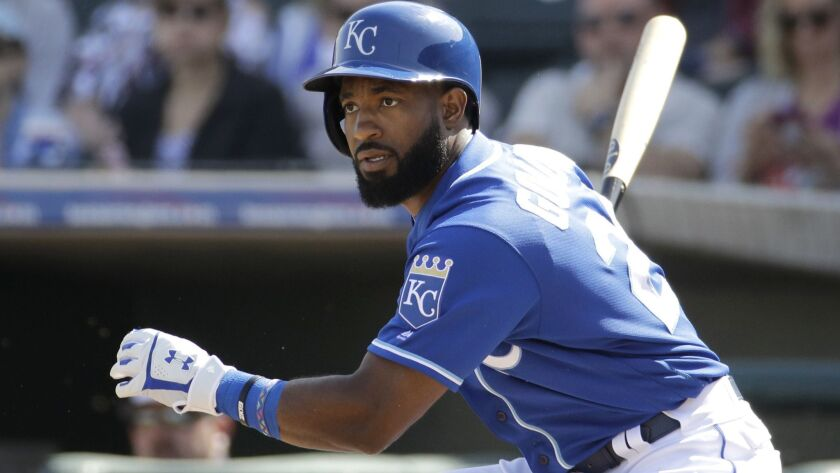 Kansas City Royals' Brian Goodwin bats during the second inning of a spring training baseball game a