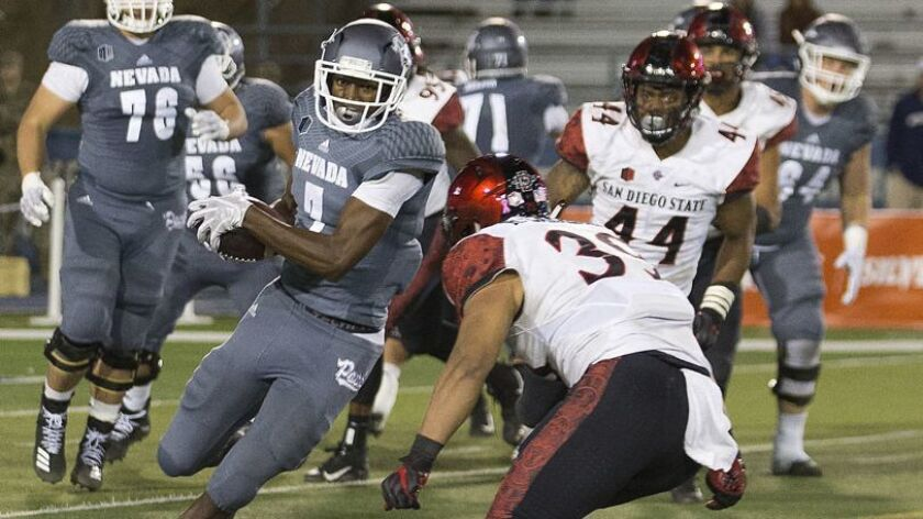 Nevada wide receiver Romeo Doubs is hit by San Diego State linebacker Ronley Lakalaka in the second half of Saturday night's Mountain West Game in Reno, Nev.