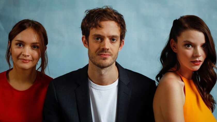 "Director Cory Finley, center, is photographed with his lead actresses Olivia Cooke (in red) and Anya Taylor-Joy, from the film, ""Thoroughbreds,"" at the London Hotel in West Hollywood."