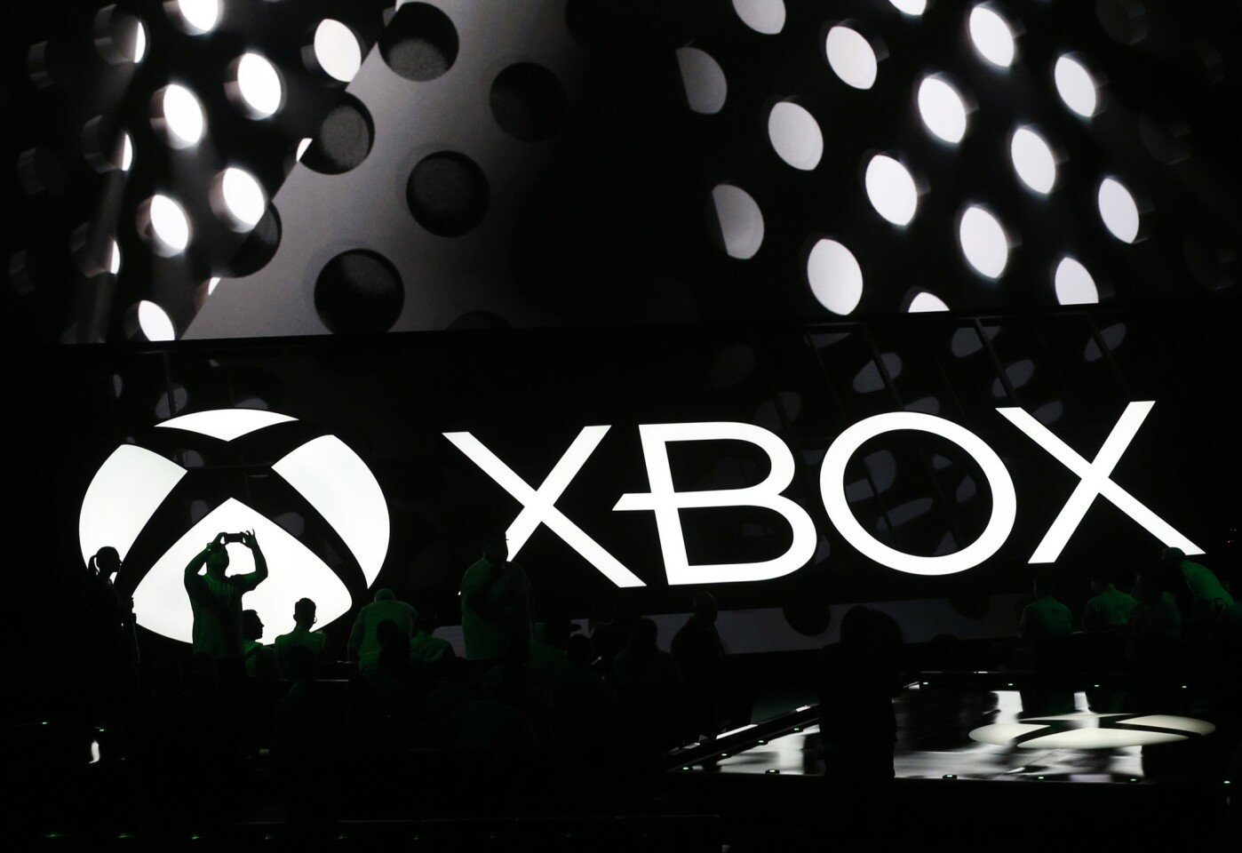 Members of the media attend a briefing at the Electronic Entertainment Expo in Los Angeles on Monday, June 13, 2016. Microsoft unveiled a new, slimmer version of the video game console coming later this year and a more powerful one that's due in 2017.
