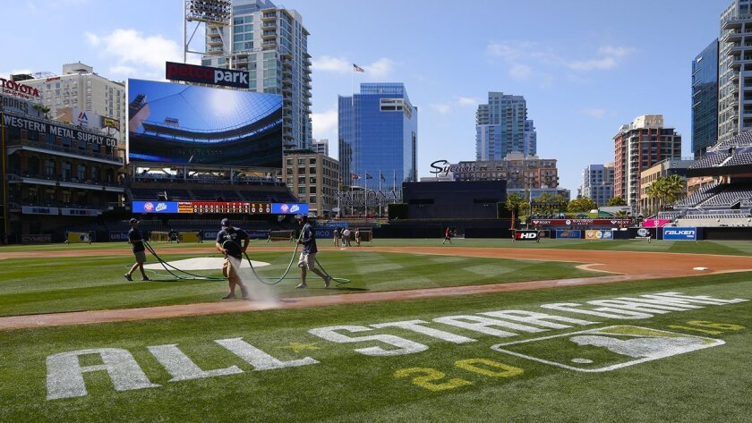Petco Park ground crew work on painting the MLB All Star Game 2016 logo on the field late Wednesday afternoon.  Petco Park hosts this year's Mid-summer Classic, played next Tuesday.