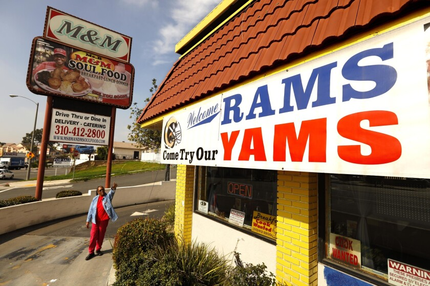 INGLEWOOD, CA - JANUARY 30, 2019 - - Beverly Brinson, owner of Ms. B's M&M Soul Food, points to the