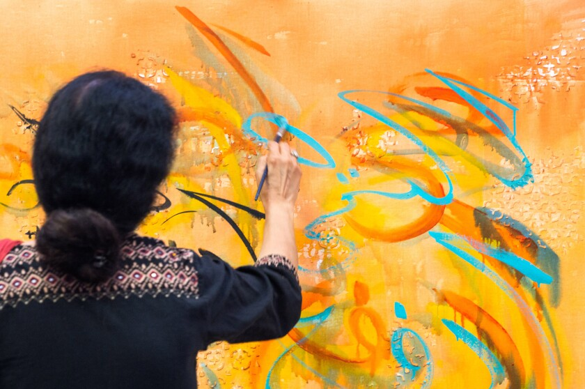 "Berkeley artist Salma Arastu uses Islamic calligraphy in a nontraditional way in her paintings. ""I want to show people what the Quran has taught me about diversity, community, friendship and peace,"" she says."