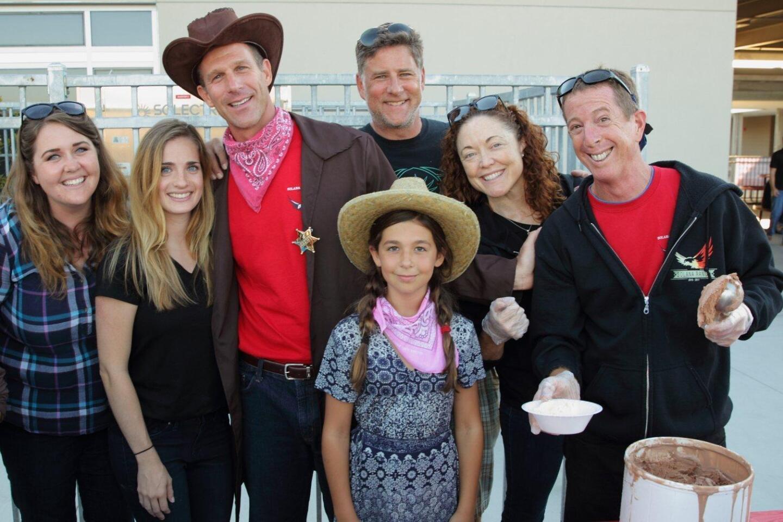 Sheriff (Principal) Jerry Jones and Sienna Jones (center) help Solana Ranch teachers serve ice cream
