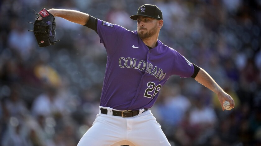 Colorado Rockies starting pitcher Austin Gomber works against the San Diego Padres in the first inning of a baseball game Monday, June 14, 2021, in Denver. (AP Photo/David Zalubowski)