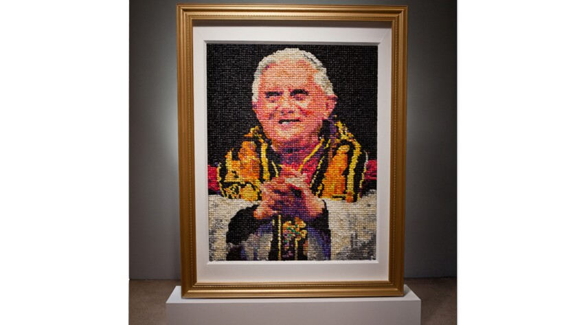 Milwaukee Art Museum has handled dozens of complaints from angry Catholics and others over its plans to display a portrait of Pope Benedict that is made from 17,000 condoms.