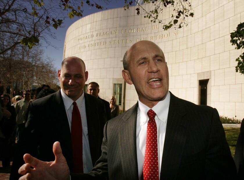 Former Orange County Sheriff Mike Carona speaks outside federal court in Santa Ana in 2009.