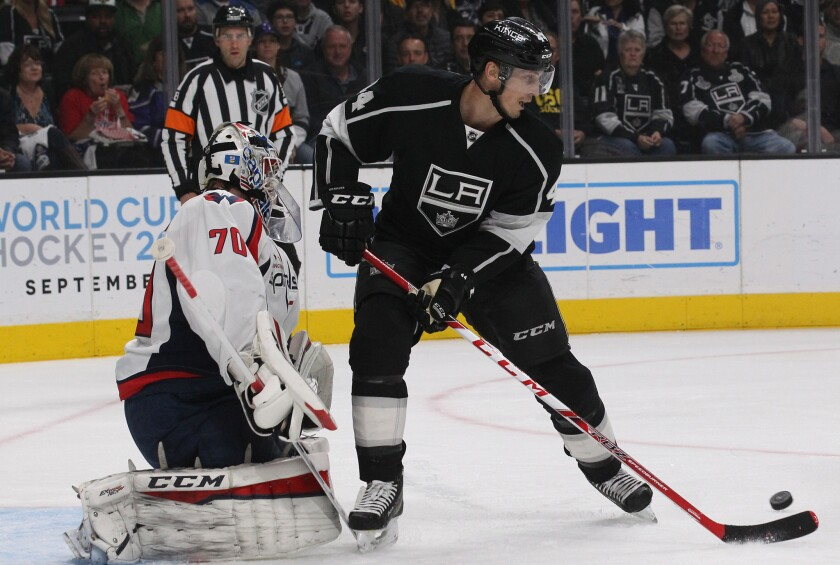 Kings center Vincent Lecavalier works the puck around Capitals goalie Braden Holtby to score a goal in the first period.