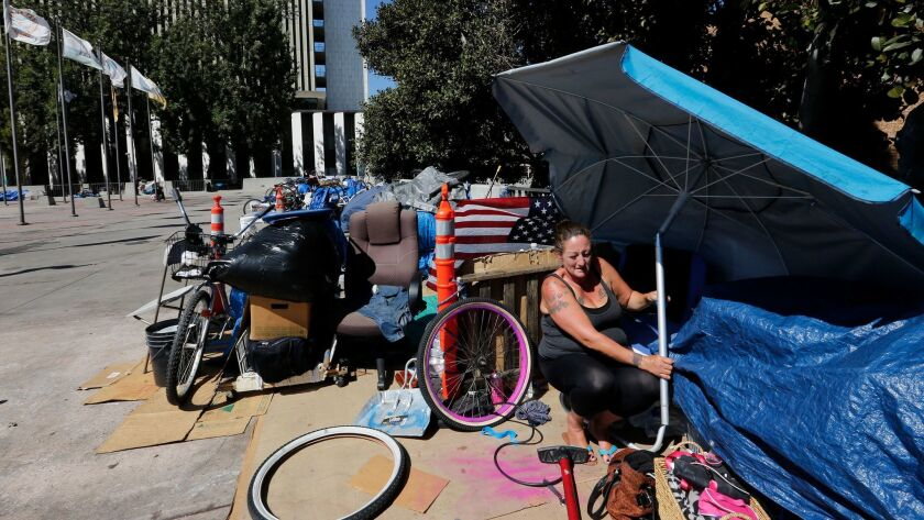 SANTA ANA, CA., SEPTEMBER 2, 2016: Homeless for several months now, Marnie Alcaraz finds a little sh