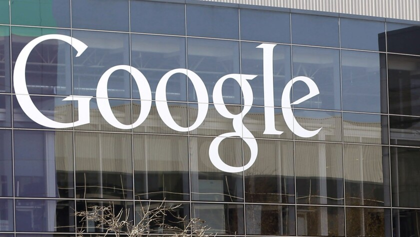 This Jan. 3, 2013, file photo shows a Google sign at the company's headquarters in Mountain View, Calif.