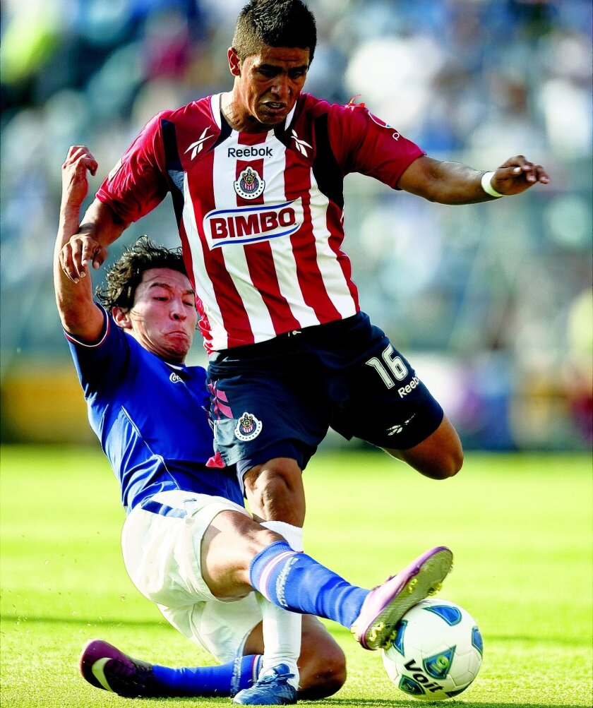 Miguel Angel Ponce of Chivas of Guadalajara (right), who was born in Sacramento and attended school in San Ysidro, vies for the ball with Cesar Villaluz of Cruz Azul.