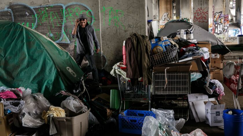 Residents of a homeless encampment under the 1st street bridge go about their daily lives in Los Angeles, Calif., on May 31, 2017.