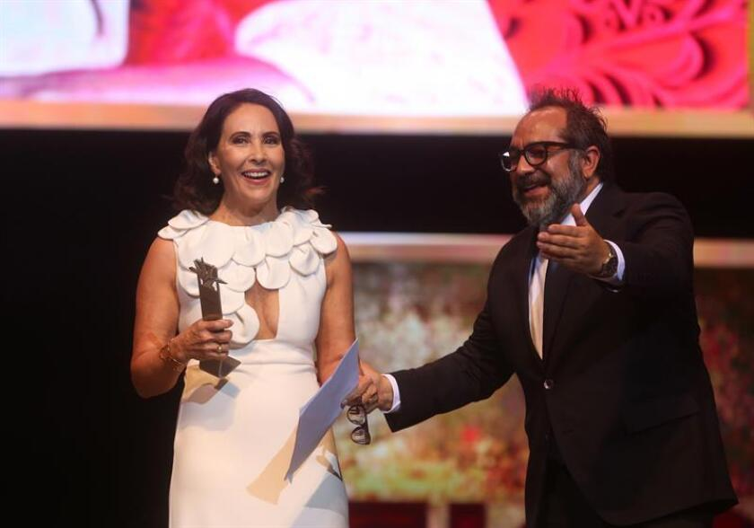 Mexican actress Blanca Guerra (L) receives the Mayahuel de Plata award for her film career from the Mexican art director Eugenio Caballero (R) during the opening of the 34th Guadalajara International Film Festival, in the state of Jalisco, Mexico, March 8, 2019. EPA-EFE/Nacho Reyes