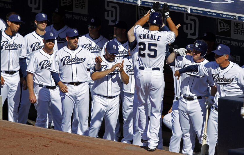 Padres Will Venable celebrates a  home run in the 1st inning against the Dodgers.