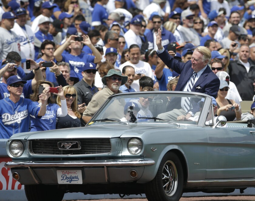 Broadcaster Vin Scully arrives on the field last month to toss out a ceremonial first pitch at Dodger Stadium.