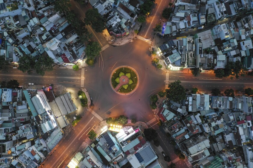 An empty intersection is seen from an aerial view in Ho Chi Minh City, Vietnam, on July 22, 2021. Vietnam's southern metropolis Ho Chi Minh City tightened restrictions with a curfew order to contain a surge of COVID-19. (AP Photo/Huu Khoa)