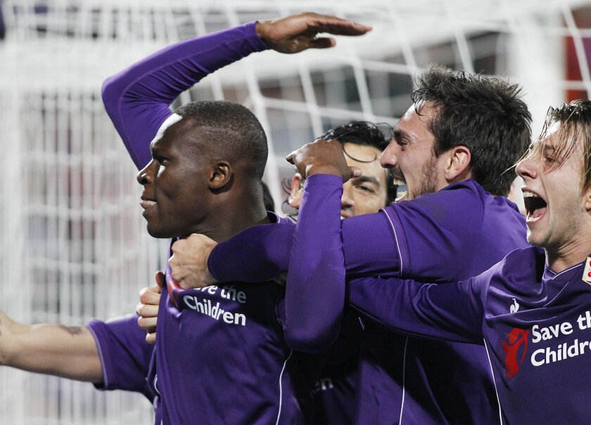 Fiorentina's Babacar, left, celebrates after scoring the winning goal during a Serie A soccer match between Fiorentina and Inter Milan at the Artemio Franchi stadium in Florence, Italy, Sunday, Feb. 14, 2016. (AP Photo/Fabrizio Giovannozzi)