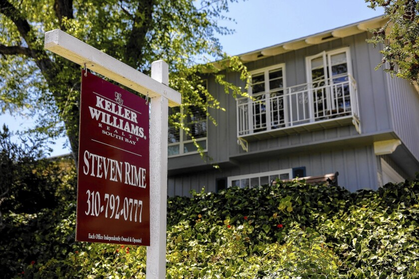 Home sales climbed in December in Southern California as price growth continued to cool off. Above, a home for sale in Redondo Beach.