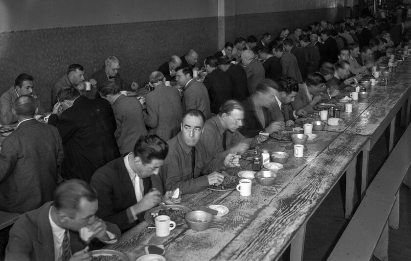 Nov. 28, 1935: Men enjoy Thanksgiving dinner at the Midnight Mission, Los Angeles. Long lines of nee