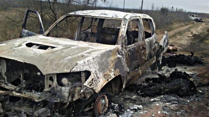 Handout photo that shows some bodies and torched vehicles at the site where authorities on Jan. 9, 2019, found 20 corpses in the northeastern Mexican municipality of Miguel Aleman, Tamaulipas state, near the United States-Mexico border. EPA-EFE/BEST QUALITY POSSIBLE