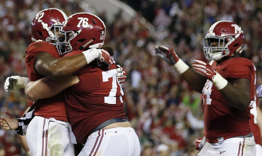 Alabama running back Derrick Henry (2) celebrates his touchdown against LSU with Alabama offensive lineman Dominick Jackson (76) in the second half of an NCAA college football game Saturday, Nov. 7, 2015, in Tuscaloosa , Ala. (AP Photo/John Bazemore)