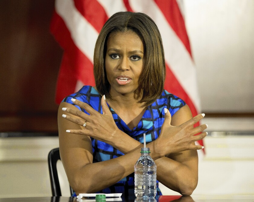 First Lady Michelle Obama defends school lunch law