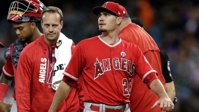 Angels starting pitcher Andrew Heaney leaves the game during the third inning because of an undisclo