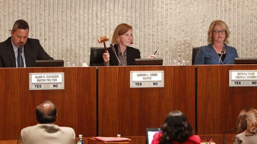 Mayor Sandra Genis, center, raises her gavel as a motion for order as opponents of Senate Bill 54 ch