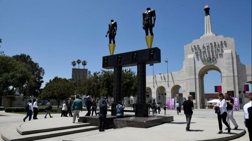 The Coliseum torch is lit during a visit from IOC evaluators on May 11.