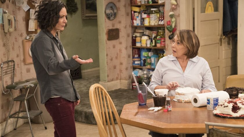 "This image released by ABC shows Sara Gilbert, left, and Roseanne Barr in a scene from ""Roseanne."" T"